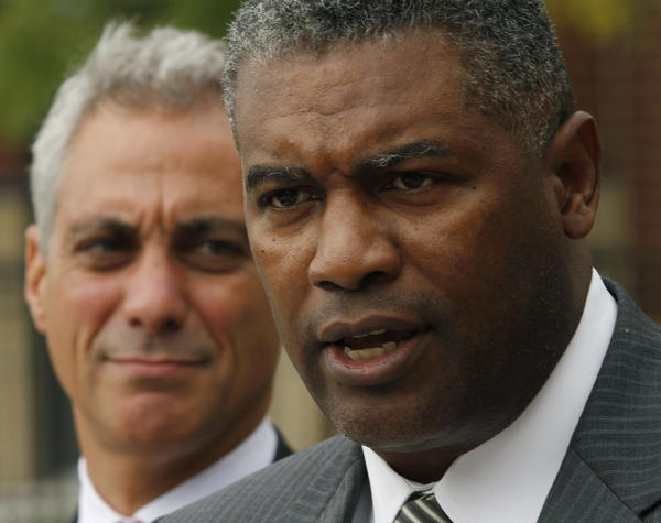 Chicago Housing Authority CEO Charles Woodyard, with Chicago Mayor Rahm Emanuel, holds a press conference on affordable houseing in 2011. Charles Woodyard is stepping down as CEO of the Chicago Housing Authority.