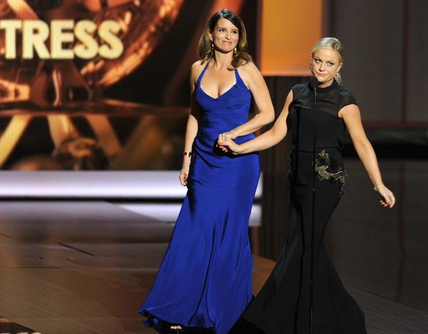 Tina Fey, left, and Amy Poehler at the 65th annual Primetime Emmy Awards.