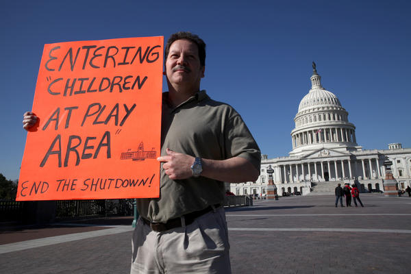 Matthew Murguia, a 53-year-old furloughed federal employee, walks around the U.S. Capitol on the 15th day of the government shutdown Tuesday.