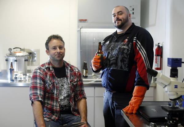 Head brewer Chris Boggess and owner Nick Floyd in the laboratory of Three Floyds brewery in Munster, Ind.