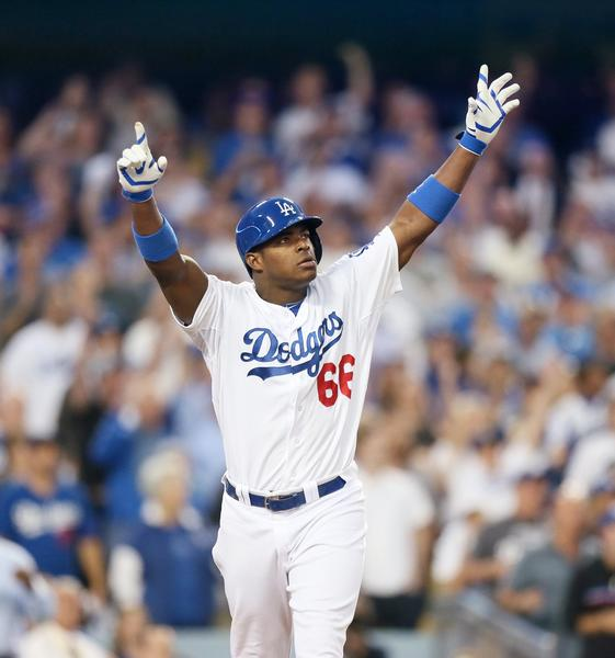 Yasiel Puig reacts after hitting an RBI-triple in the fourth inning during Game 3 of the National League Championship Series.