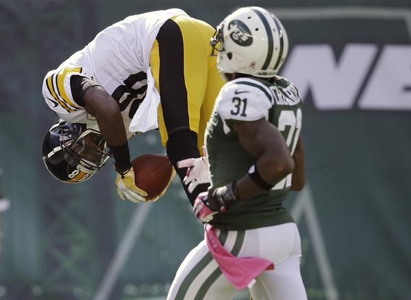 Pittsburgh's Emmanuel Sanders flips into the end zone for a touchdown in front of New York Jets' Antonio Cromartie on Sunday.