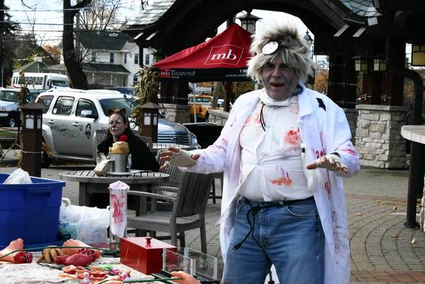 A fake bloody man stands in front of the Oak Park Avenue train station with dismembered body parts at last year's Boo Bash. This year's event on Oct. 27 should be bigger, organizers say.