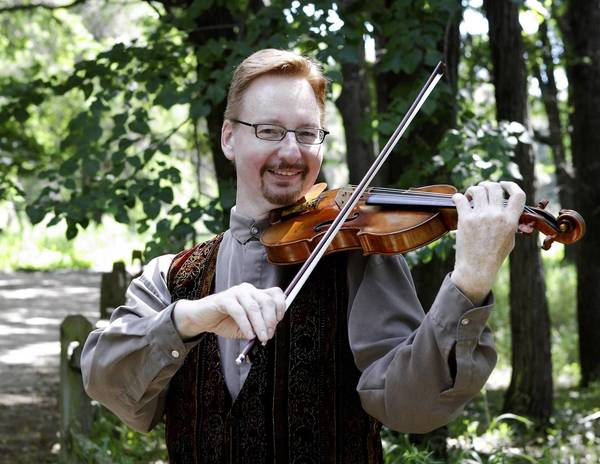 Tinley Park's Carl Johnston will get to play the piece that made him want to become a violinist when the Illinois Philharmonic Orchestra opens its 36th season Saturday at Lincoln-Way North High School.