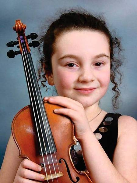 Nine-year-old violin prodigy Michelle Stern performs with the CT Virtuosi Chamber Orchestra Oct. 20 at Central Connecticut State Unviersity's Welte Hall.