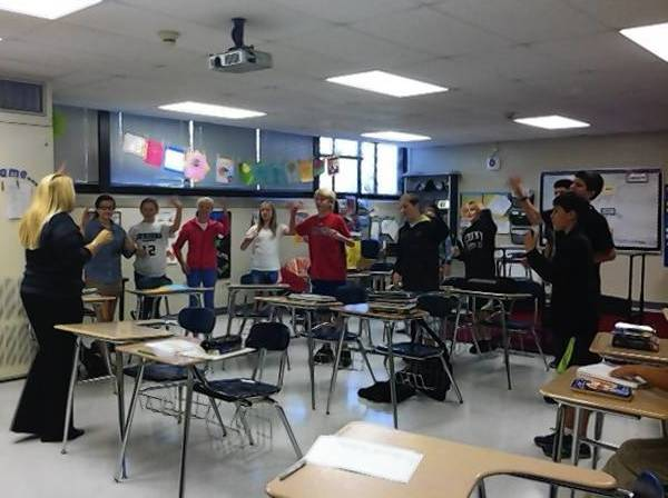 Students engaged in a 'brain break' or physical activity exercise during third period health class at Lake Bluff Middle School.