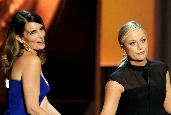 Tina Fey, left, and Amy Poehler will be returning to host the Golden Globes.