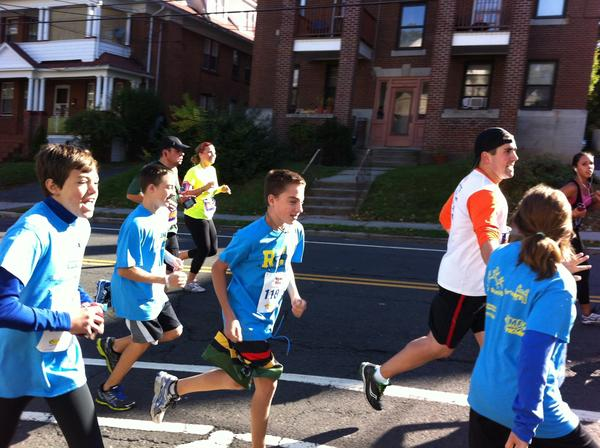 Students from Sedgwick Middle School and Webster Hill Elementary School ran a relay race half-marathon as part of the Jeff's Running Partners program of the ING Hartford Marathon on Saturday. Sedgwick students are pictured running with health teacher Craig Archambault.