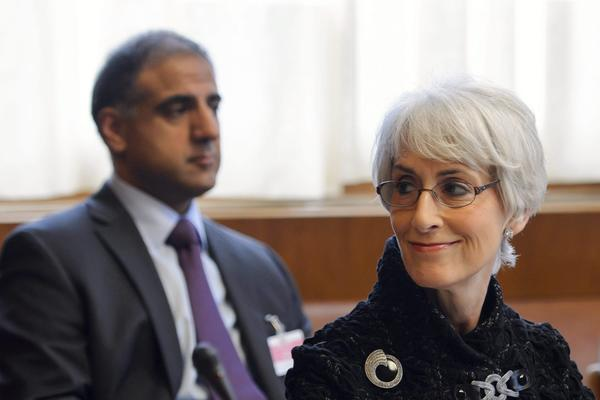 U.S. Undersecretary for Political Affairs Wendy Sherman smiles at the start of the two days of closed-door nuclear talks in Geneva on Tuesday.