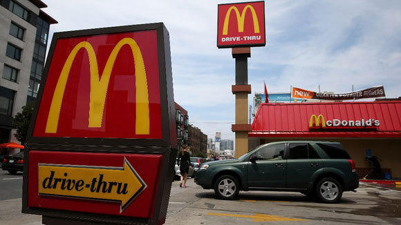 A car leaves a McDonald's in San Francisco in July.
