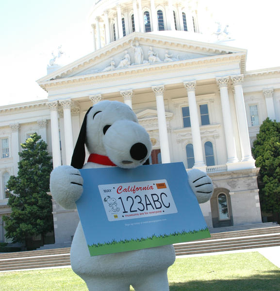 A prototype of the Snoopy license plate is displayed in front of the state Capitol in Sacramento.