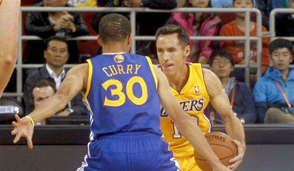 Steve Nash is defended by Golden State's Stephen Curry during the first half of Tuesday's exhibition game in Beijing, China.