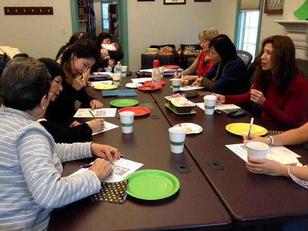 A group of English language learners, shown here, meets once a week at the Plainfield Public Library to sharpen their writing and grammar skills.