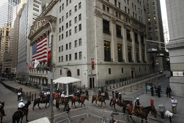 A mounted police unit stands guard in front of the New York Stock Exchange last year as several hundred protesters take part in a march through the financial district of New York.