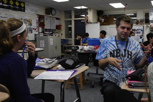Northbrook Junior High School eighth grade language arts teacher Michael LaCerra interacts with students during class.