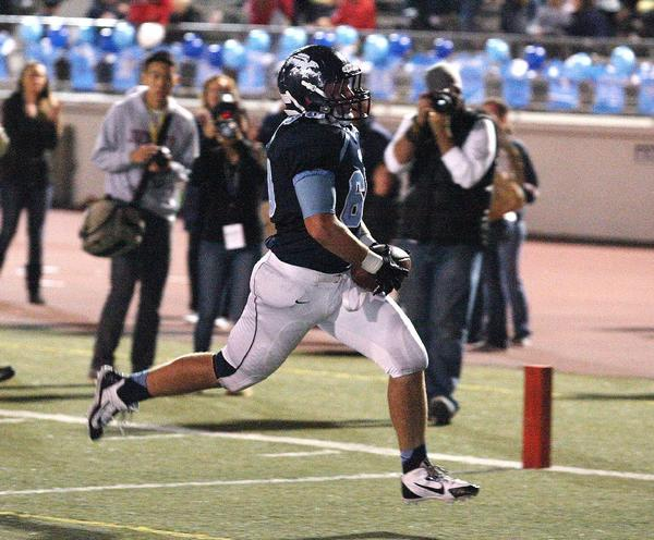 Crescenta Valley High football's Ryan Cancelosi coasts into the end zone during the Falcons' 48-47 overtime win over Burbank.