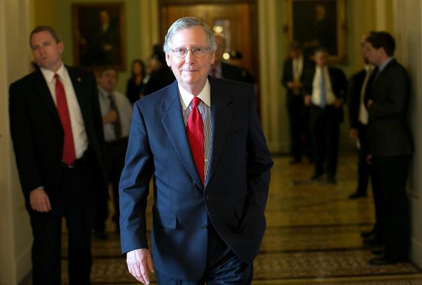Senate Minority Leader Sen. Mitch McConnell (R-Kan.) returns to his office after a meeting of Senate Republicans at the Capitol in Washington.