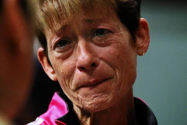 Donna Roberts, facing, cries with Vikkie Drzyzga after a Heroin Epidemic Relief Organization meeting at Lincolnway Christian Church in New Lenox. Roberts' husband, John, founded the group with another father, Brian Kirk, after both families lost sons to a heroin overdose.