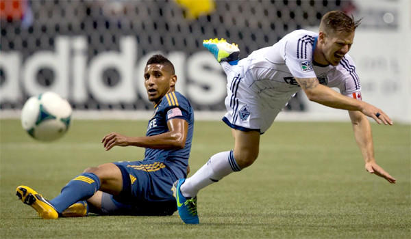 The Galaxy's Sean Franklin trips Vancouver's Jordan Harvey during L.A.'s 1-0 win over the Whitecaps on Aug. 24.