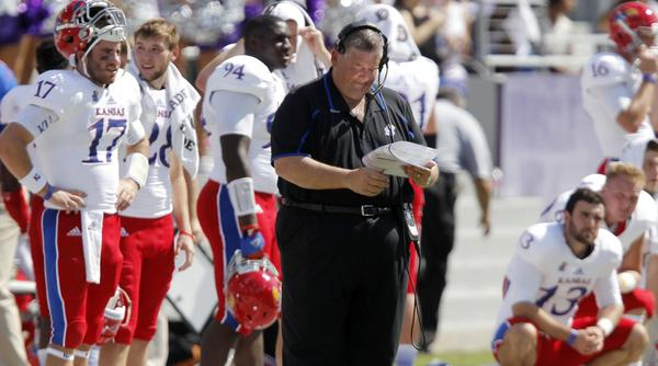 Kansas coach Charlie Weis consults his notes during action against TCU.