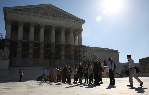 Spectators line up outside of the United States Supreme Court in Washington D.C.