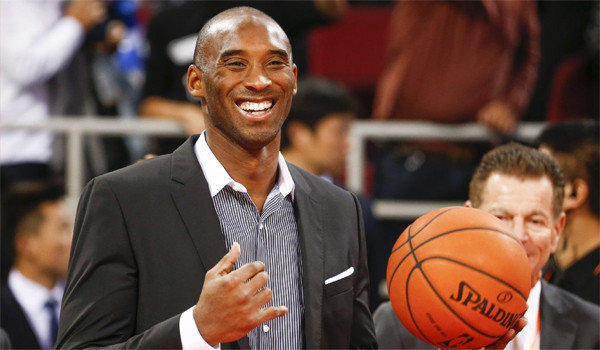 Kobe Bryant smiles before the Lakers face the Golden State Warriors in an exhibition game in Beijing.