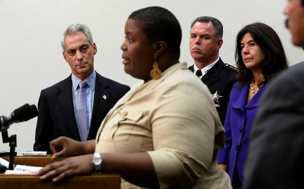Mayor Rahm Emanuel, left rear, is joined by police Superintendent Garry McCarthy, State's Attorney Anita Alvarez and Cleopatra Cowley-Pendleton, foreground, mother of slain teen Hadiya Pendleton, at a Tuesday City Hall news conference promoting a bill that would require minimum three-year sentences for illegal gun possession.