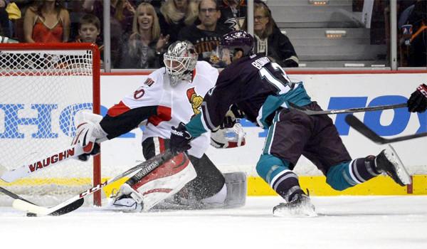 Ducks forward Nick Bonino tries to slip the puck past Ottawa Senators goalie Robin Lehner during the first period of Anaheim's 4-1 win Sunday.