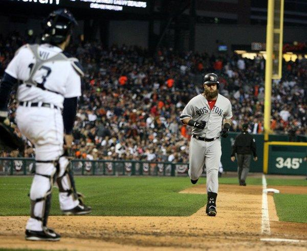 Mike Napoli heads home after hitting a solo home run in the seventh inning against the Tigers during Game 3.