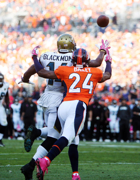 Jaguars wide receiver Justin Blackmon attempts to catch a pass while being covered by Broncos cornerback Champ Bailey during the second half.