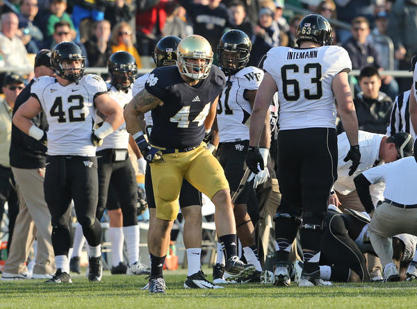 Notre Dame linebacker Carlo Calabrese reacts after forcing a fumble during the first half of their game against Wake Forest.