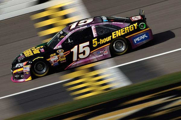 Clint Bowyer, driver of the #15 Raspberry5-hourEnergybeneLivingBynd Toyota, practices for the NASCAR Sprint Cup Series 13th Annual Hollywood Casino 400.