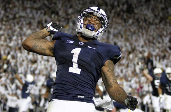 Penn State's Bill Belton celebrates after rushing for the game-winning touchdown against Michigan.