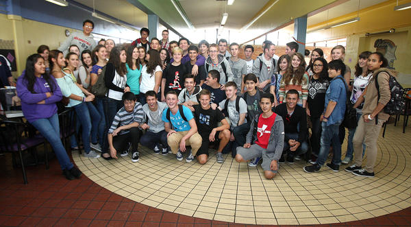 Hoover High School students and their 40 French pen pals gather for a big group photo in the cafeteria during a reception at Hoover High School in Glendale on Monday, Oct. 14, 2013. The French students will be attend Hoover for two weeks, just as Hoover students did last year in France.