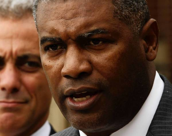 Chicago Housing Authority CEO Charles Woodyard, right, with Mayor Rahm Emanuel in September 2011, resigned from his post this week two years into his term.