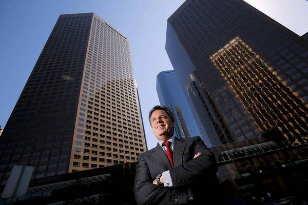 Bert Dezzutti of Brookfield Office Properties stands in front of the Wells Fargo Center on Bunker Hill in downtown Los Angeles. Brookfield now controls both towers in the center after completing its purchase of MPG Office Trust.