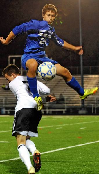 Southern Lehigh's Nathan Smith (24) jumps near Northwestern Lehigh's Kyle Willis during the Colonial League semifinals.
