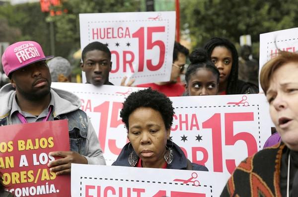 Fast-food workers and activists calling for wages of $15 an hour rally Tuesday near Chicago's Rock 'n' Roll McDonald's.