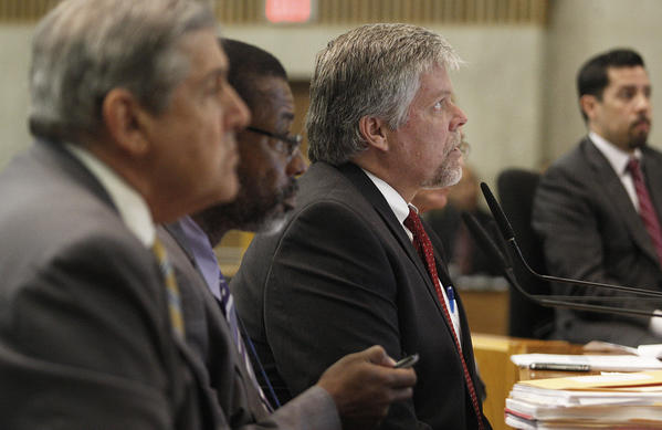 L.A. County probation chief Jerry Powers, center, at a Board of Supervisors meeting in August 2013, says the county does not have the money or staff to supervise prisoners released by the state because of overcrowding.