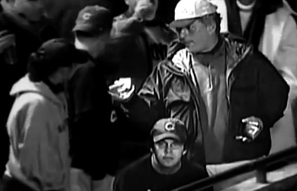 Steve Bartman, foreground, wouldn't speak with Tribune columnist John Kass, right, shortly after Bartman interfered with a foul ball at Wrigley Field.