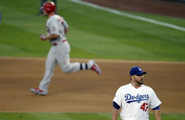 Cardinals outfielder Matt Holliday runs the bases after hitting a two-run home run off Dodgers starter Ricky Nolasco in the Dodgers' 4-2 loss in Game 4 of the National League Championship Series on Tuesday.
