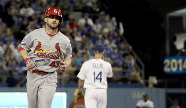 Shane Robinson rounds the bases after hitting a home run in the seventh inning off Dodgers reliever J.P. Howell during the Cardinals' 4-2 win over the Dodgers in Game 4 of the National League Championship Series.