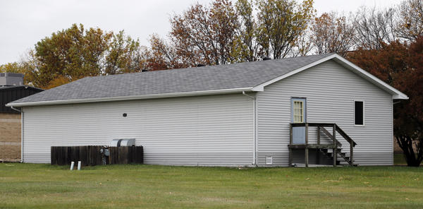 This building, which is currently located east of First Baptist Church, was purchased by Brown County officials for use on the Brown County Fairgrounds.