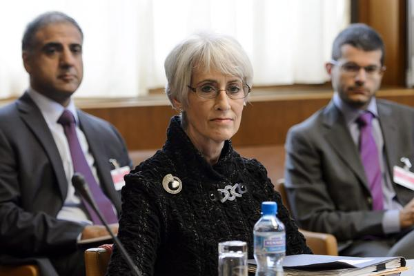 In Geneva, U.S. Undersecretary of State Wendy Sherman waits for the start of a round of talks on Iran's nuclear program.