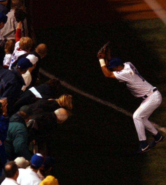 Moises Alou reacts after failing to catch a foul ball during the 2003 NLCS.