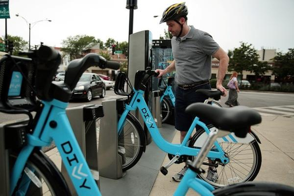 A Divvy user wearing a helmet is about as rare a sight as a smile on Jay Cutler's face.