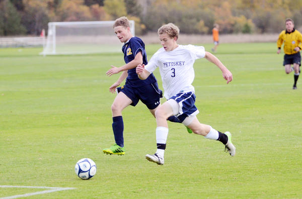 Petoskey senior Austin Redes (right) chases down a ball as Gaylord's Austin Frisch gives chase during Tuesday's Division II district opener at the Click Road Soccer Complex. Redes had a pair of goals as the Northmen defeated the Blue Devils, 3-1. Petoskey will play at Cadillac at 6 p.m. Thursday, Oct. 17, in a district semifinal.