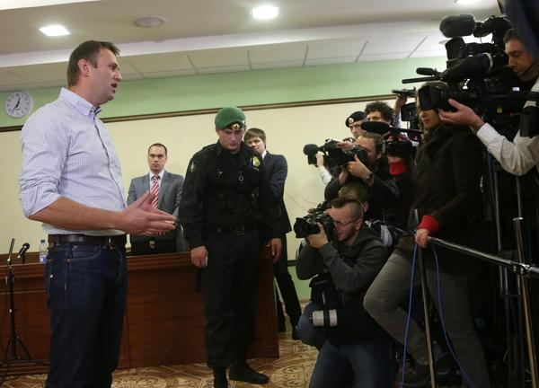 Russian opposition leader and anti-corruption blogger Alexey Navalny talks to media after a hearing Wednesday at the regional court in Kirov, Russia.