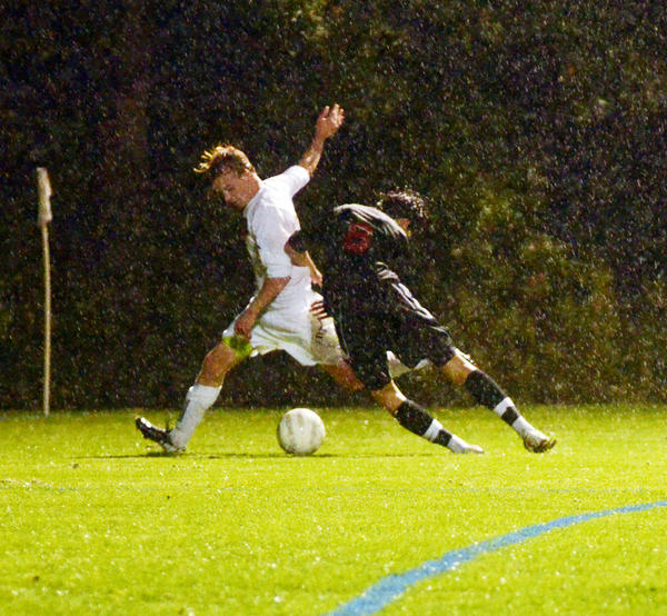 Harbor Springs forward John Bailey (left) is blocked from the ball by Bellaire defender Denny Hall (right) near the goal during a Division IV soccer district game Tuesday at Ottawa Stadium in Harbor Springs.
