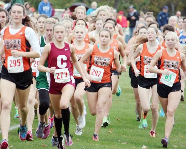 Harbor Springs Claire Fleming (from left) Charlevoixs Amber Way and Harbor Springs' Jessica Worm, Kyra LaRue, Autumn Kihnke and Betsey Simons work toward the front of the pack during Tuesdays Lake Michigan Conference championships at Antrim Dells Golf Course in Atwood. Way won the girls race in 18 minutes, 23 seconds.